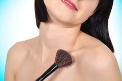 Woman applying blusher Royalty Free Stock Photography