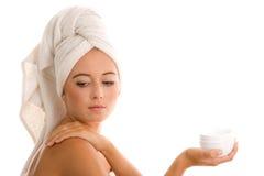 Woman applying body cream Royalty Free Stock Photos