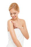 Woman applying body cream on shoulder Stock Photos