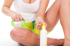 Woman applying cellulite cream on her leg Royalty Free Stock Photo