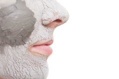Woman applying clay mask on face. Spa. Royalty Free Stock Photography