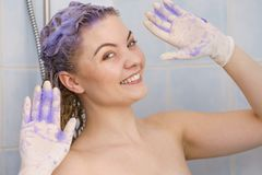 Woman applying toner shampoo on her hair stock images