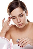 Woman applying concealer Royalty Free Stock Photo