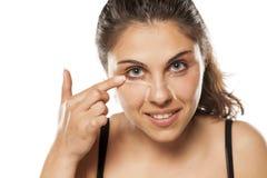 Woman applying concealer Royalty Free Stock Image