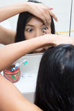 Woman applying contact lens Royalty Free Stock Photography