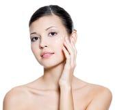 Woman applying cosmetic  cream around the eye Stock Photo