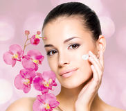 Woman applying cosmetic cream  on face Stock Photo