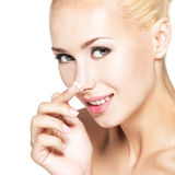 Woman applying cosmetic  cream on the nose Royalty Free Stock Photo