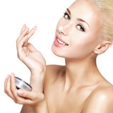 Woman applying cosmetic  cream on the nose Royalty Free Stock Image