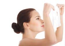 Woman applying cosmetic facial mask Stock Photo