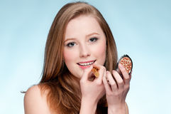 Woman applying cosmetic lipstick Royalty Free Stock Images