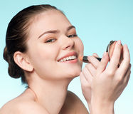 Woman applying cosmetic lipstick Royalty Free Stock Photography