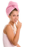 Woman applying cosmetic on nose Stock Photos