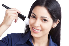 Woman Applying Cosmetic Paint Brush Stock Photo