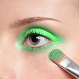 Woman applying cosmetic paint brush on eye zone Stock Photo