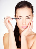 Woman applying cosmetic pencil on eye Royalty Free Stock Image