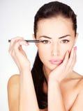 Woman applying cosmetic pencil on eye Royalty Free Stock Image