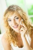 Woman applying cosmetics. At home stock image