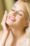 Woman Applying Cream Royalty Free Stock Image
