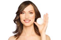 Woman applying cream Royalty Free Stock Photos