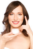 Woman applying cream Stock Image