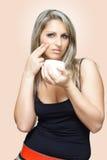 Woman Applying Cream Stock Image