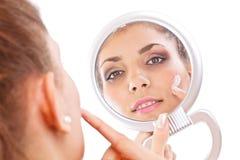 Woman applying cream Stock Photo