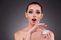 The woman applying cream in beauty concept Stock Photography