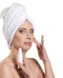 Woman applying cream for face Stock Image