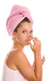 Woman applying cream on face Royalty Free Stock Photo