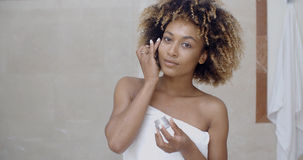 Woman Applying Cream On Her Face Royalty Free Stock Image