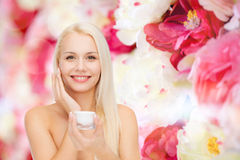 Woman applying cream on her skin Royalty Free Stock Photo