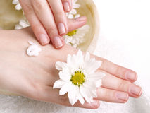 Woman applying cream to her hands Stock Image