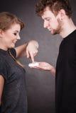 Woman applying cream to her man face. Stock Photos