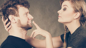 Woman applying cream to her man face. Royalty Free Stock Photography