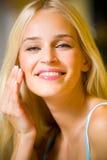 Woman applying creme Royalty Free Stock Images