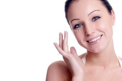 Woman applying creme on face Royalty Free Stock Image