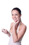 Woman applying creme on face Royalty Free Stock Images