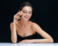 Woman applying cushion for powder. Royalty Free Stock Photo