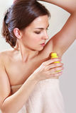 Woman applying deodorant Royalty Free Stock Photo