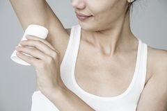 Woman applying deodorant on her armpit. Woman applying deodorant  on her armpit royalty free stock images