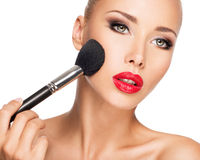 Woman  applying dry cosmetic tonal foundation  on the face Royalty Free Stock Images