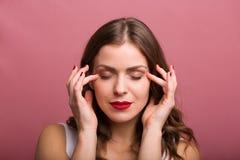 Woman applying an eye cream stock photo