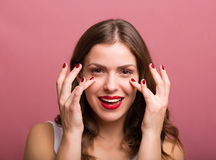 Woman applying an eye cream Royalty Free Stock Photography