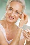 Woman applying eye makeup Royalty Free Stock Photography