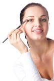 Woman applying eye shadow Royalty Free Stock Photo