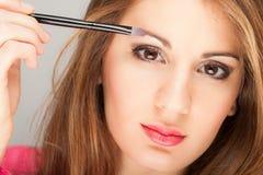 Woman applying eye shadow Royalty Free Stock Photos