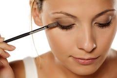 Woman applying eye shadow Royalty Free Stock Image