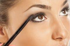 Woman applying eye-shadow Royalty Free Stock Photography