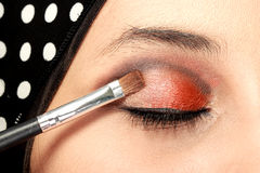 Woman applying eye shadows Royalty Free Stock Photo